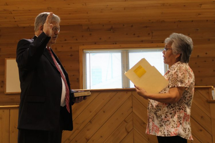 Haley Gustafson | Daily Press Terry Pearson, left, gets sworn in as chief of police for the Hannahville Tribal Police Department by Tribal Vice-Chair Elaine Meshigaud Monday in the tribal administration building's courtroom.