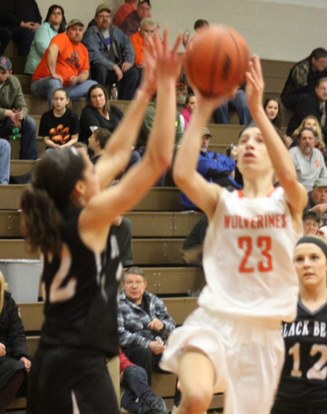 Avery Bundgaard | Daily Press Kennedy Englund (23) of Mid Peninsula drives toward the basket as Brooke Dalgord (22) of Big Bay de Noc defends Thursday at Mid Pen.