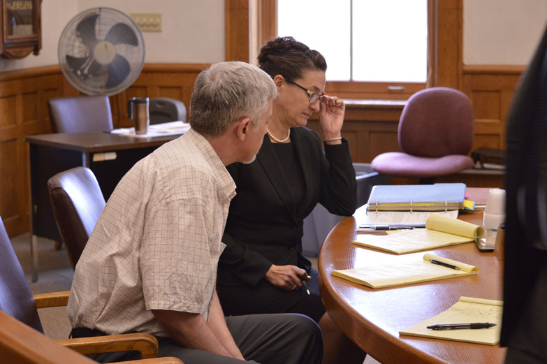 Ilsa Matthes | Daily Press Gregory Ihander and his attorney, Karen Groenhaut, look at notes during a brief recess Thursday. Ihander is charged with the murder of Jolene Eichhorn.
