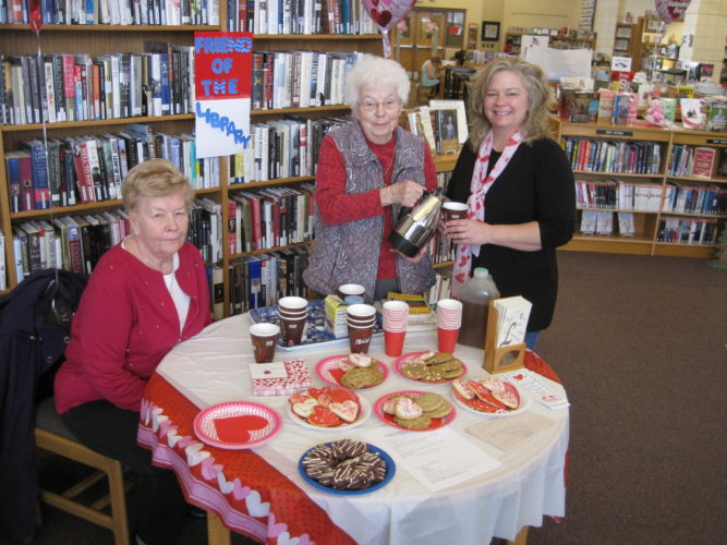 "Courtesy photo Brenda Crow enjoyed refreshments served by volunteers Mary Martinson and Bernadine Harris during the ""Love Your Library"" open house that was held on Valentine's Day. The open house is an annual event sponsored by the Friends of the Library to inform the public of the services available at the library."