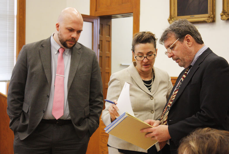 Jenny Lancour | Daily Press During a break in the murder trial of Gregory S. Ihander in Menominee County Circuit Court on Monday, Prosecutor William Merkel, pictured at right, converses with Defense Attorney Karen Groenhout and her assistant, Attorney Alex Sieminski.