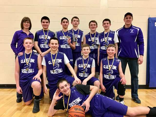 Courtesy photo The Gladstone 8th graders won an eight-team basketball tournament in Kingsford last weekend.  The team includes front row: Lucas Hughes.  Middle row from left: Gavin Berg, Dylan Pepin, Blake Krouth and Owen Trombley.  Back row: Coach Sailer, Sean Sailer, Zachary Brazeau, Cameron Ballard, Ryan Polley and John Falcon.