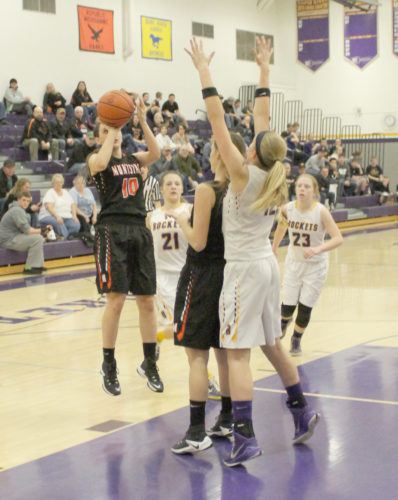 Avery Bundgaard | Daily Press Munising's Marissa Immel pulls up for a shot over Rapid River's Erica Rubick Thursday night at Rapid River. Immel scored her 1,000th career point in the second quarter.