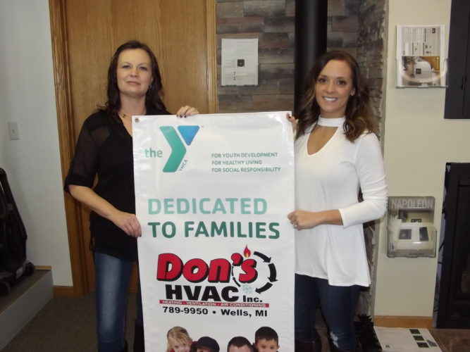 Dons donation YMCA