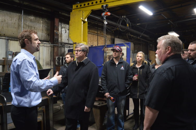 Jordan Beck | Daily Press Independent Machine Company (IMC) President Chris Doyle, left, speaks to State Sen. Tom Casperson and other members of a tour group during an open house event Friday.