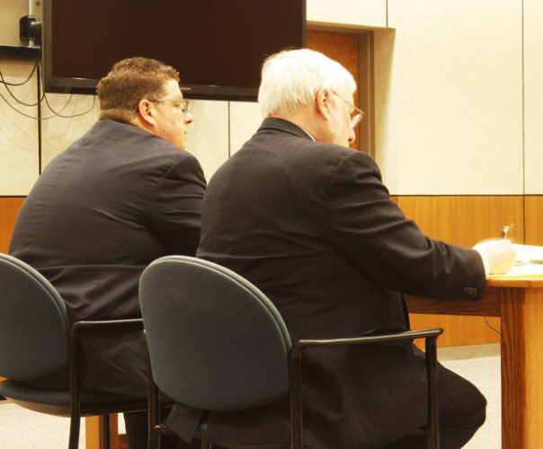 Jenny Lancour | Daily Press Steven Jacob Marciniak, 46, of Escanaba, at left, sits with his attorney, Timothy Cain, during witness testimony on the first day of his trial in Delta County Circuit Court on Tuesday.