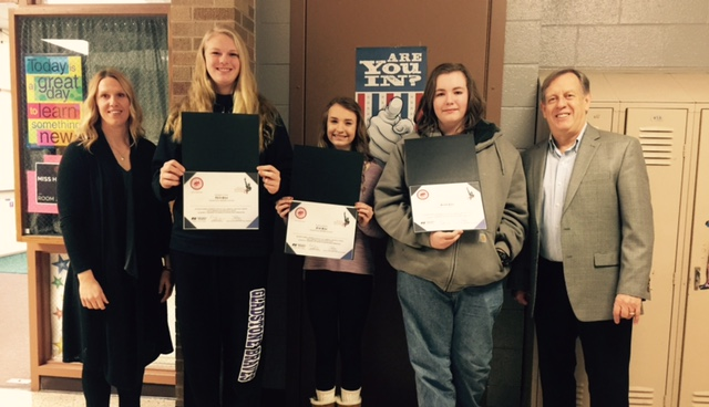 Courtesy photo The local winners from the Gladstone Middle School of the American and Me Essay contest are from left, Miss. Hughes, English teacher at Gladstone Middle School, Megan Crow - third place, Payton Nault - first place, Nate Highsmith - second place, and Rick Jensen, Farm Bureau Insurance agent.