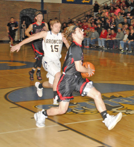 Burt Angeli | The Daily News North Central's Bobby Kleiman races past Nick Lippens (15) to the basket.
