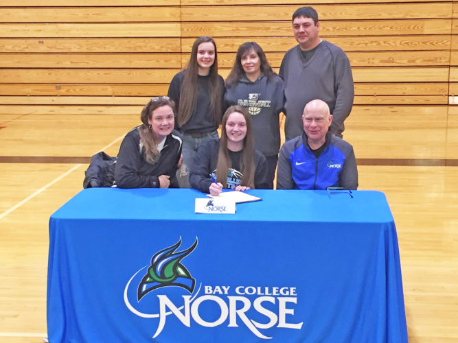 Courtesy photo St. Ignace senior basketball player Jordan Belleville recently signed a national letter of intent to attend Bay College. Pictured at the signing are, front row from left, St. Ignace coach Dorene Ingalls, Belleville and Bay women's coach Rae Drake Jr. In back row are Belleville's sister Jerzie and parents Tina and Dan Belleville.