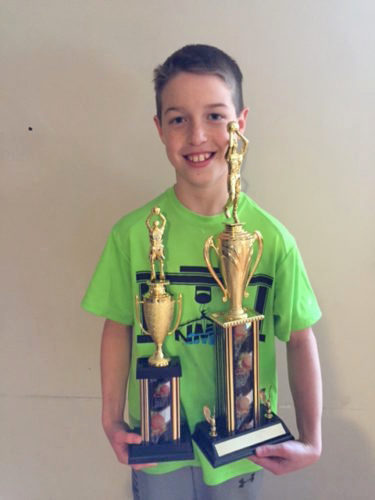 Courtesy photo Escanaba's Bryson Lancour won the Knights of Columbus Hoop Shoot regional competition Sunday in Negaunee. He then earned the 10-year-old boys' state title after making 22-of-25 free throws. Lancour, a fifth-grader at Escanaba Upper Elementary, won the state title while competing against downstate regional winners who were shooting their free throws in Mount Pleasant.