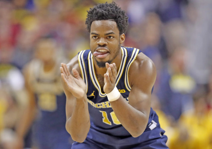 AP photo Michigan guard Derrick Walton Jr. reacts during the first half of the Big Ten championship game Sunday against Wisconsin. Walton has fueled Michigan's turnaround since early February and will now try to lead the Wolverines on an extended run in the NCAA Tournament.