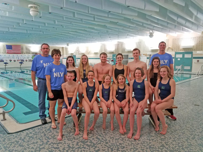 Courtesy photo Twelve swimmers from the Northern Lights YMCA swim team are headed to Brown Deer, Wis., this weekend to compete in the Wisconsin/U.P. YMCA State Swimming Championship meet at Walter Schroeder Aquatic Center.  More than 350 swimmers will be in attendance.  Pictured bottom row from left are:  Nate Lanaville, Adrianna Getzloff, Kamryn LaVigne, Irene Neumeier, Ava Getzloff and Carney Salo.  Top row from left are: Coach Rick Prica, Coach Amy Rouleau, Anna Rouleau, Esther Oswald, Andrew Dykema, Katie Stephenson, Matt LeClaire, Abby Rouleau, and Head Coach Scott Dykema.