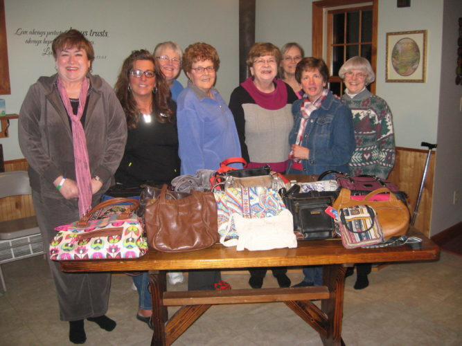 Courtsy photo Covenant women from the Gladstone Covenant Church met at the home of Tammy Carlson to pack twenty-five purses to be given to Safe Harbor, the area's women's shelter. From left, Cindy Brock, Tammy Carlson, Carol Cervantes, Kerstin Sigfred, Judy Larsen, Betty Nyberg, Karen Langager, and Betty Giovenco.  Each purse was filled with contents to assist the recipient in making a renewed beginning.