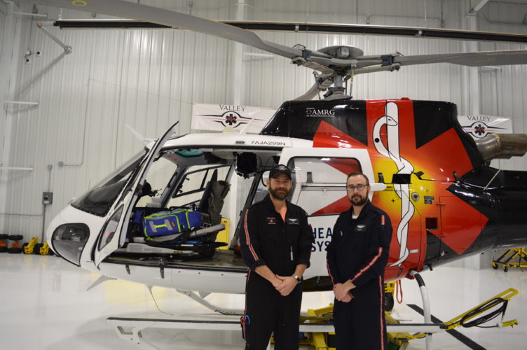 Jordan Beck | Daily Press Valley Med Flight Flight RN/Paramedic Luke Racine, left, and Pilot Nikita Wilson, right, are pictured in front of the AStar helicopter used by Valley Med Flight in Escanaba Friday.