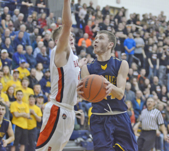James Gensterblum photo Negaunee senior Dre Tuominen, right, attacks the basket against Manton's Trever Salani during the Class C quarterfinal game played at Petoskey High School Tuesday night.