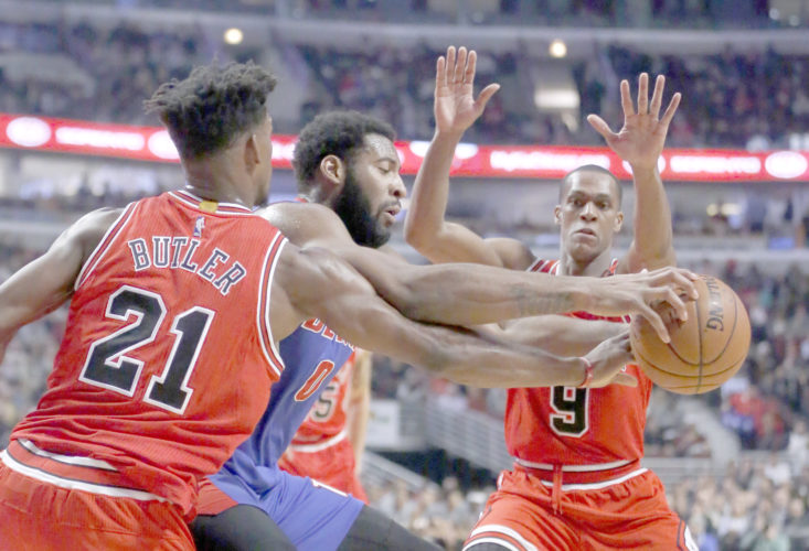 AP photo Chicago Bulls' Jimmy Butler (21) strips the ball from Detroit Pistons' Andre Drummond as Rajon Rondo (9) also defends during the first half Wednesday in Chicago.