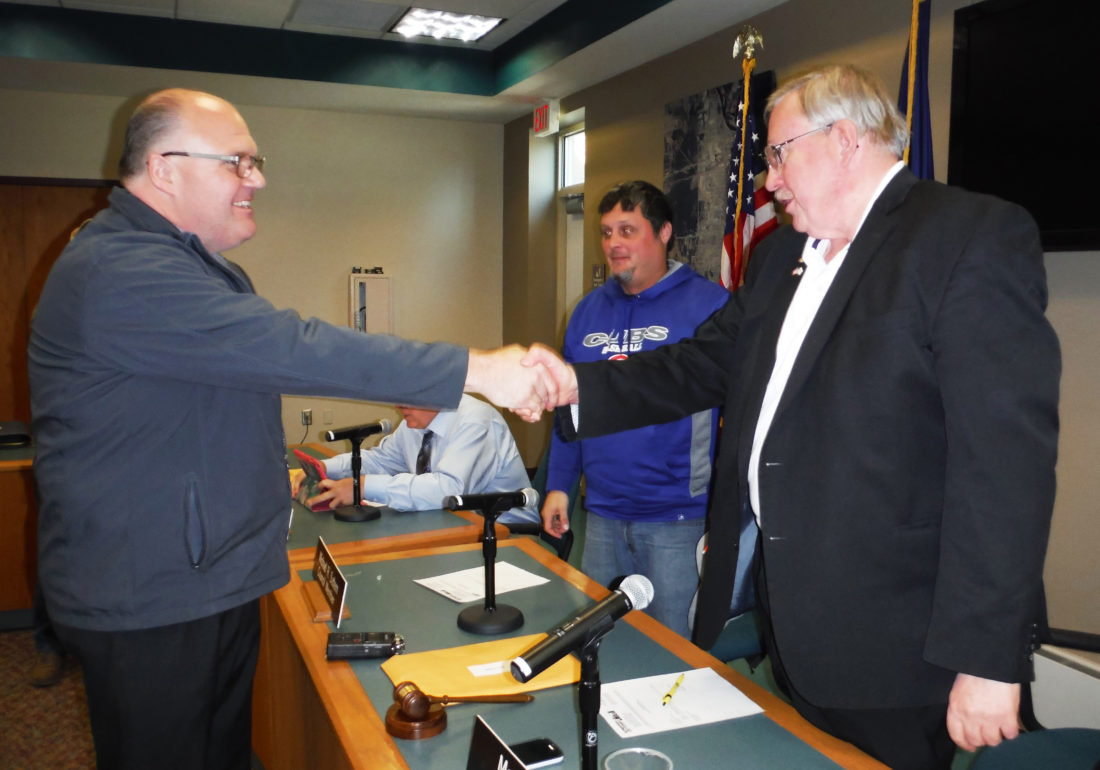 Jenny Lancour | Daily Press Jeff Thornton, of Negaunee, at left, shakes hands with Escanaba Mayor Marc Tall as Council Member Michael Sattem looks on following council's decision to hire Thornton as the new city ­manager during a special meeting at city hall Wednesday. Thornton will replace Jim O'Toole, who is ­retiring July 3.
