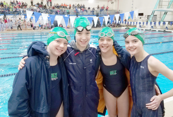 Courtesy Photo Pictured from left to right are NLY swimmers Ava Getzloff, Adalaide McRoberts, Adrianna Getzloff, and Sierra Scott during the State meet in Brown Deer, WI this past weekend.