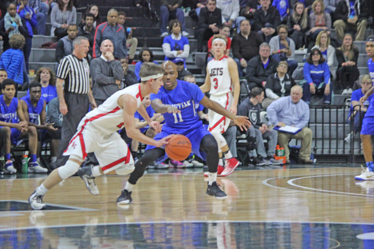 Dennis Grall | Daily Press Seth Polfus of North Central dribbles past Southfield Christian defender Bryce Washington in the second quarter of Thursday's Class D semifinal basketball game at the Breslin Center in East Lansing.