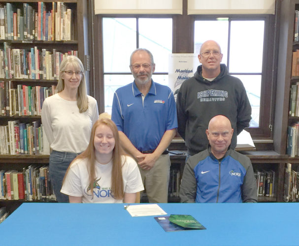 Courtesy photo Marissa Maino signs her Letter of Intent to play basketball for Bay College. Pictured from left to right are Rebecca Maino, Marissa Maino, Ishpeming AD Terry Roberts, Geno Maino, and Bay coach Rae Drake.