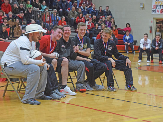 Mike Mattson | Daily Press North Central welcomed home its Class D state championship basketball team Saturday night with a celebration at the high school. Sharing a light moment at the celebration are from left, seniors Ryan Plunger, Bobby Kleiman, Jason Whitens, coach Adam Mercier, Dawson Bilski and Marcus Krachinski.