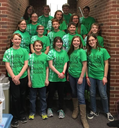 Courtesy photo Holy Name Catholic School's Science Olympiad team members include: front row, left, Stephen Weinert, Jonathan Weinert, Ariella Murray, Ava Burrows, and Lisette LaFave; second row, left, HNCS Middle School Science Teacher Ms. Amy Chartier, Braden Beauchamp, Joey Kositzky, TJ Nault, and Caleb Ouwinga; third row, left Cierra Scott, Allison Korpi, and Morgan Gartland; and  back row, left, Grace Sviland, Tony Liss, Adam Willette and Eastin Young.