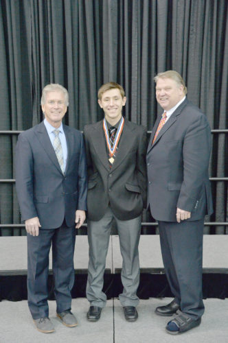 Courtesy photo Seth Polfus, center, of North Central High School is presented with the MHSAA's Scholar-Athlete Award last weekend by executive director of the MHSAA, John E. Roberts, left, and vice president of marketing for Farm Bureau Insurance, Vic Verchereau, right. Farm Bureau Insurance awarded 32 scholarships to students with a 3.50 or higher grade point average who have previously lettered in at least one sport.