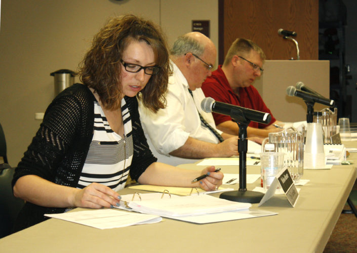 Jenny Lancour   Daily Press Escanaba City Controller Melissa Becotte goes over the city's proposed water department budget with City Manager Jim O'Toole, in middle, and Water/Wastewater Superintendent Jeff Lampi during Monday's 2017-18 budget work sessions at city hall.