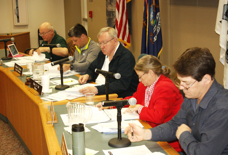 Jenny Lancour   Daily Press The Escanaba City Council reviews the city's proposed 2017-18 budget during Tuesday's work session at city hall. Council members made a few adjustments to the document, which will be revised and available to the public prior to next month's approval. From left are Ralph Blasier, Michael Sattem, Mayor Marc Tall, Pat Baribeau and Ron Beauchamp.