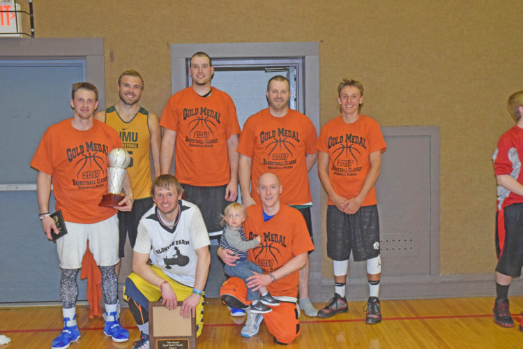 Mike Mattson | Daily Press Carney Juice Promotions captured the Class A championship Sunday in the 79th annual Gold Medal Tournament at the Hermansville Community Center. Members of the title team are,  front row from left: Jake Polfus and Jason Boucher; back row from left: Geoff Smart, Brett Branstrom, Jared Benson, Justin Bloniarz and Marcus Krachinski.