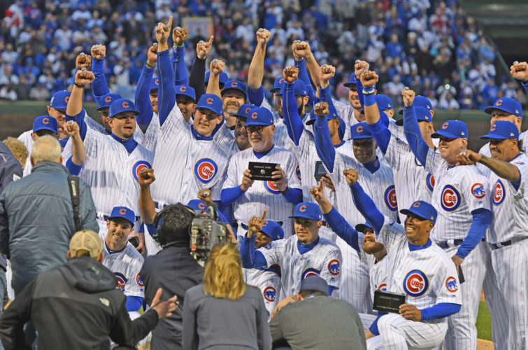 AP photo Chicago Cubs' team members celebrate during the 2016 World Series championship ring ceremony before the team's baseball game against the Los Angeles Dodgers on Wednesday.