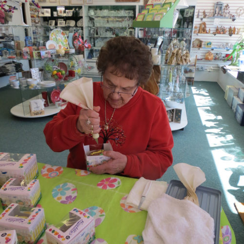 Dorothy McKnight A fortunate youngster will be the recipient of a personalized fudge Easter egg signed by Marie Mayville. At age 88, Marie is the youngest daughter of Sayklly founders, Joseph and Marie Sayklly of Escanaba. She has been working in the family business for most of her adult life.