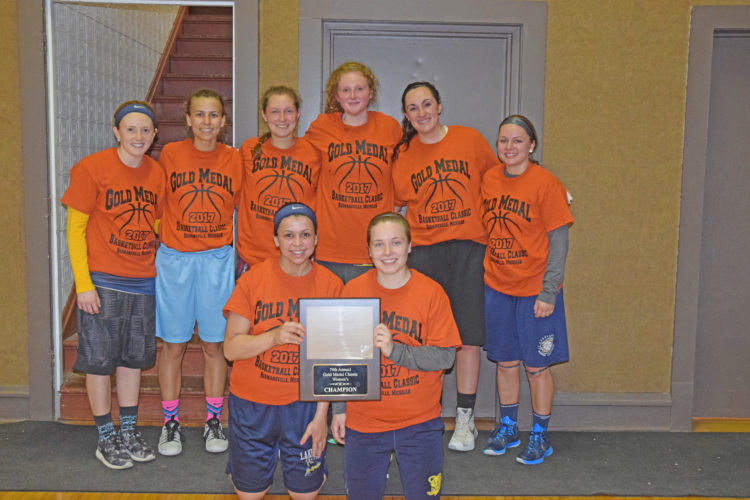 Mike Mattson | Daily Press Engaged Social Networking of Egg Harbor, Wis., captured the women's division title Sunday in the 79th annual Gold Medal Tournament at the Hermansville Community Center. Members of the title team are, front row from left: Bailey Grayvold and  Kayla Clark; back row from left: Lexie Greenback. Brittany Grayvold.  Jordan Kraemer. Mandy Doll. Trista Barron and Lexi Capperet.