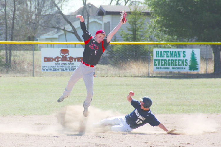 Adam Niemi | The Daily News North Central second baseman Hunter Riley catches a high throw as Norway's Bryce Broden slides safely into second base on Friday in Hermansville.