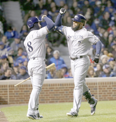 AP photo Milwaukee Brewers' Eric Thames, right, celebrates his home run off Chicago Cubs starting pitcher John Lackey, with Ryan Braun, during the third inning Monday in Chicago.