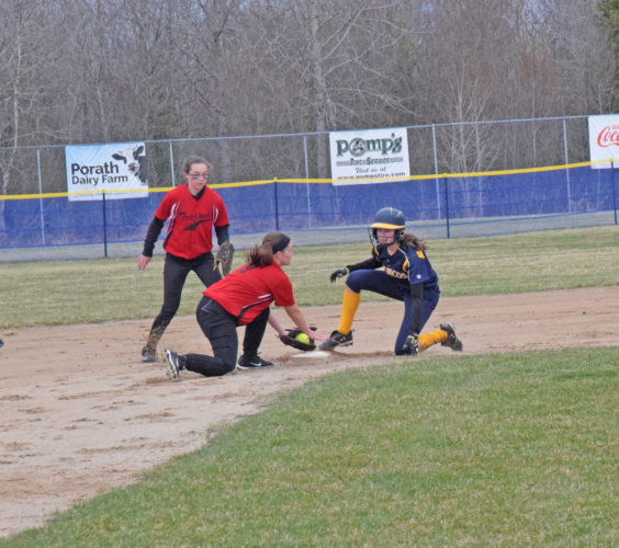 Mike Mattson | Daily Press Bark River Harris' Brianna Mlostek steals second base ahead of the throw in Tuesday's first game against Forest Park. Trojans' shortstop Maddie Thoreson catches the ball and second baseman Indy Hundley backs up the play.
