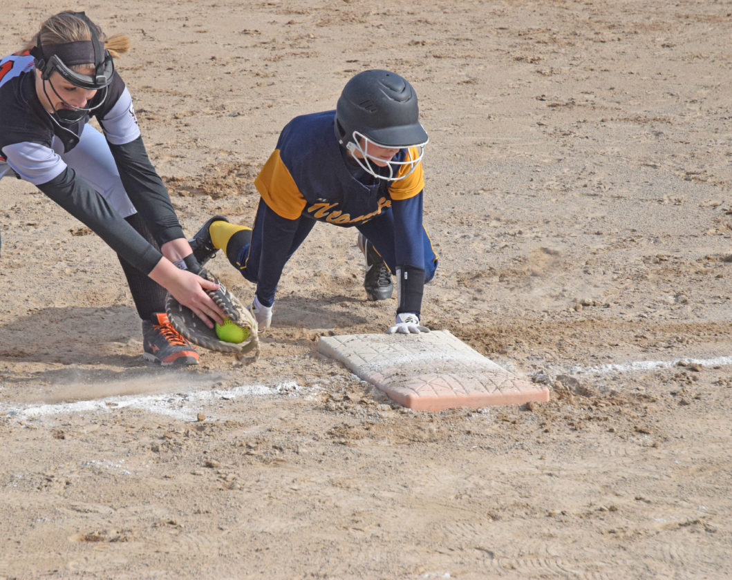Mike Mattson | Daily Press Escanaba first baseman Savanah Barron, left, attempts a late tag on Negaunee runner Delaney McLaughlin on a pickoff attempt in Wednesday's first game.