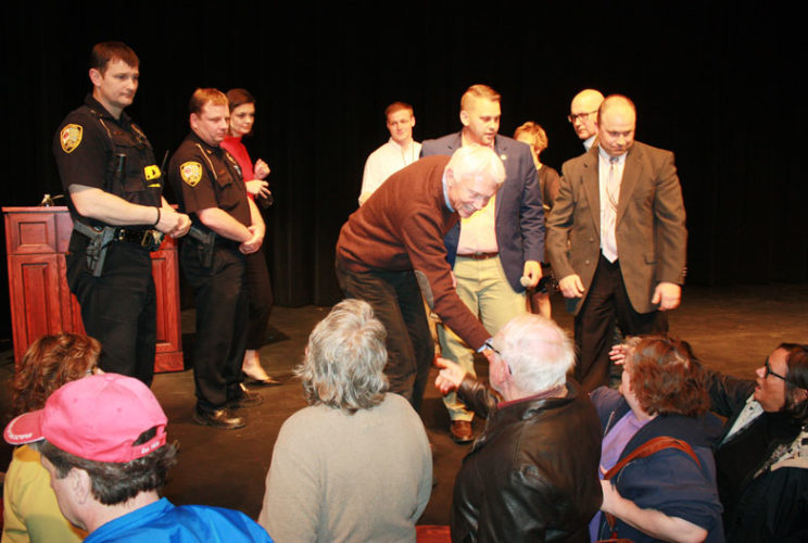 Jenny Lancour | Daily Press Individuals shake hands with U.S. Congressman Jack Bergman following a townhall meeting Wednesday at Bay College in Escanaba where security was high. On stage with Bergman are members of his staff and Escanaba Public Safety (EPS) Officer Lt. Marc Zawacki, far left, EPS Director Rob LaMarche, second from left, and EPS Det. Lt. Darin Hunter, far right.