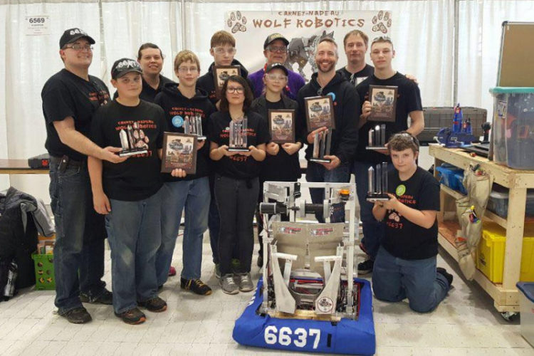 Courtesy photo Members of Carney-Nadeau Wolf Robotics are pictured along with the awards they won this year. The team will complete their first year participating in FIRST Robotics at the world championship in St. Louis, Mo. next week, where they will compete with the Gladstone and Bark River-Harris teams.