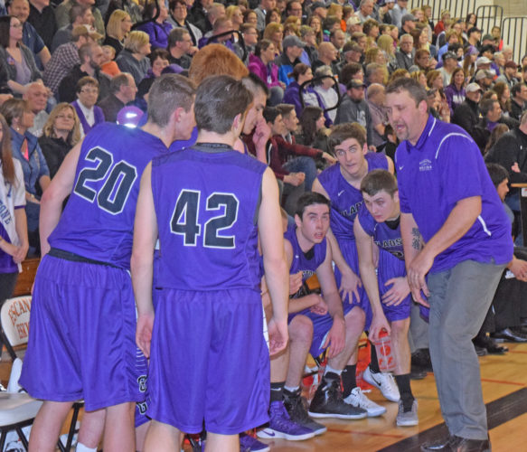 Mike Mattson | Daily Press Gladstone coach Clayton Castor fires up the Braves during a timeout in the March district championship game at Escanaba. Castor has resigned from his duties after two years as varsity coach.