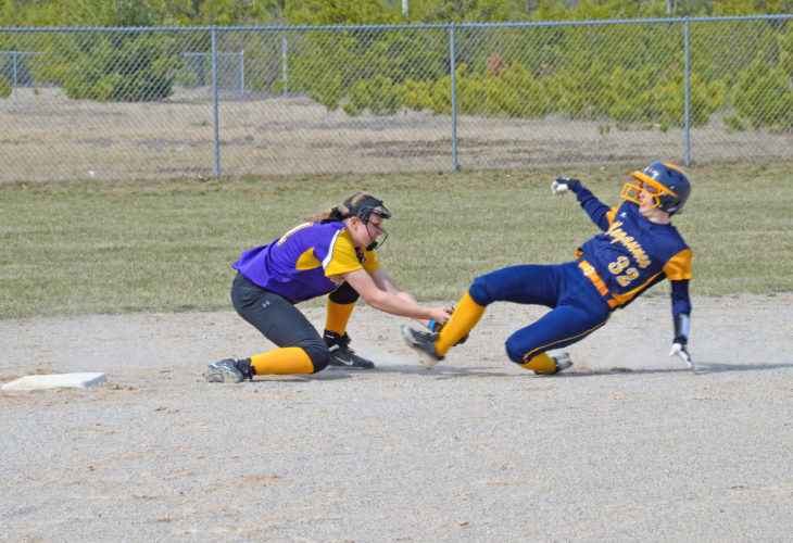 Courtesy photo Rapid River shortstop Erica Rubick tags out Negaunee's Hailey Fezatt on a play at second base in Monday's non-conference action.