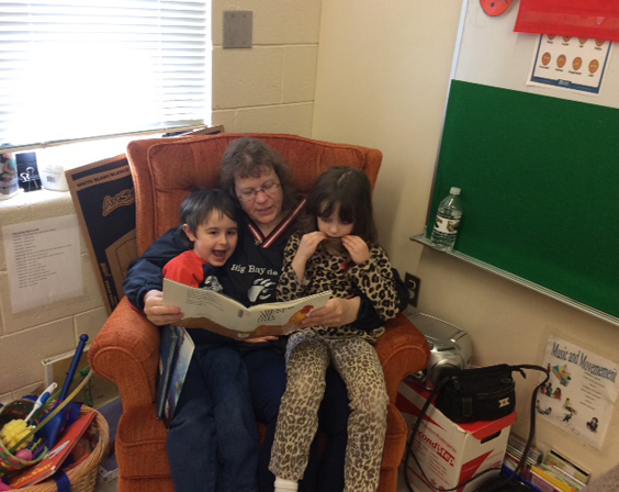 Courtesy photo John Miller and his friend, Genevieve Pichette, listen to grandparent Theresa MIller reading them a story.