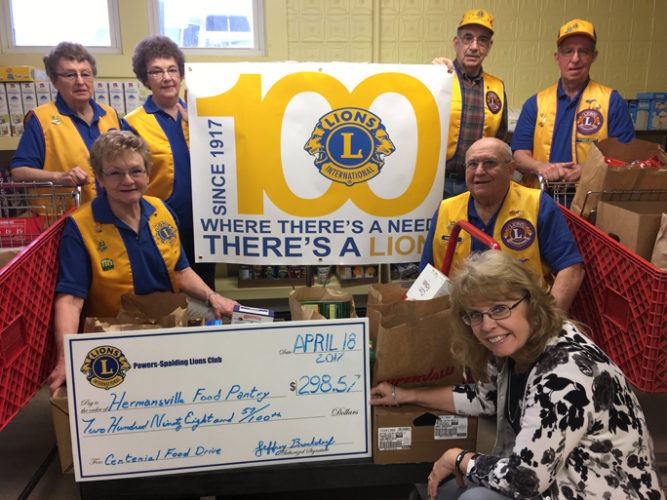 Courtesy photo The Powers-Spalding Lions Club held a two day fund raising project to celebrate the National Lions Club Centennial. Numerous non-perishable items and $298 were delivered to Pam Huluska at the Hermansville Food Pantry. Over 30 families benefit monthly from the pantry. Lion's members from left, Eleanor LeBoeuf, Dorothy O'Neil, Tom Wells, and Benny O'Neil, top row, with Judy Malak and Richard Malak, middle row, and Pam Huluska accepting the check.