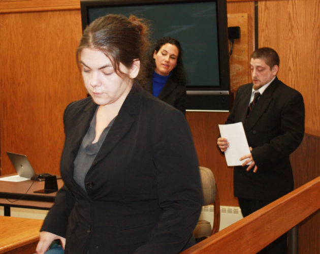 Jenny Lancour | Daily Press  Parents of a 3-year-old girl who was found lying naked shivering in a ditch in Rapid River on St. Patrick's Day, appeared in Delta County Probate Court for a hearing Thursday. Pictured above are the child's mother, Tammy Fryer, at left, and the father, Michael Lavoie, at right. LaVoie's attorney, Katherine Clark, is behind Fryer.