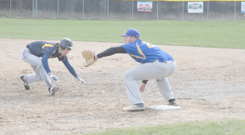 Mike Mattson | Daily Press Bark River-Harris runner Jace Briggs attempts to return to first base, but is late and tagged out by the Kingsford first baseman in Friday's first game.