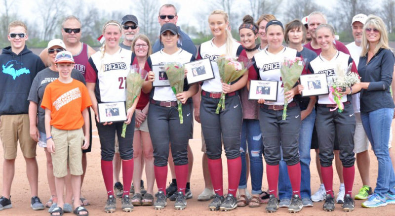 Courtesy photo Rapid River's Heather Sanderson, far left, was one of five senior softball players recently honored by the University of Northwestern Ohio in Lima, Ohio. It was the first four-year senior class of the school and Sanderson was the lone transfer honored. Sanderson also pitched the Racers to their first-ever victory (5-1) on that day against NAIA nationally-ranked Davenport University. Sanderson, who has a team-best 18-9 pitching record and 2.69 ERA, is a transfer from the University of Wisconsin-Green Bay. Other seniors pictured with Sanderson from left are: Kayley Keller, Chelsea Miller, Kristen Buck, and Casey Yingst.