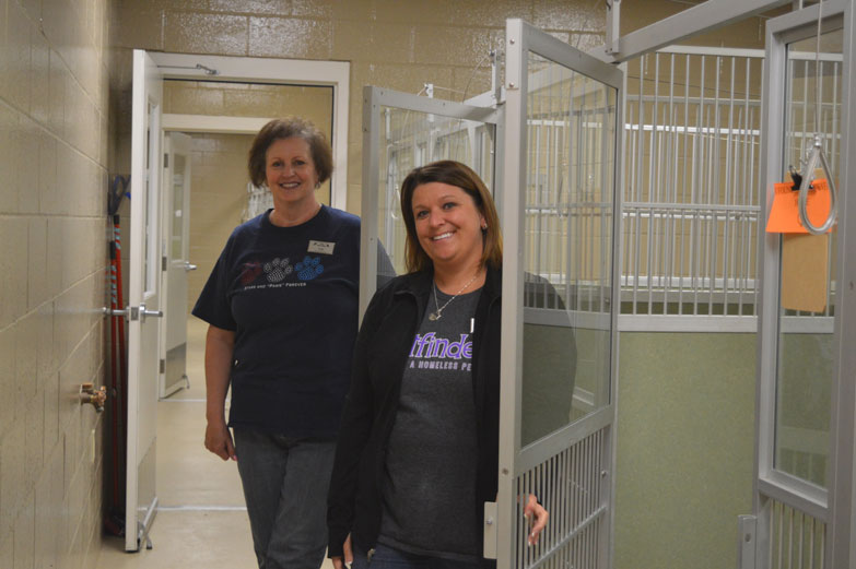 Haley Gustafson | Daily Press Vicki LeGault, in background, an adoption specialist at the Delta Animal Shelter, and Tonya Gartland, special events coordinator at the shelter, pose by empty dog kennels at the Delta Animal Shelter in Escanaba Tuesday. The kennels were emptied after the Empty the Shelters event held Saturday, where the BISSELL Pet Foundation sponsored all adoption fees for that day.