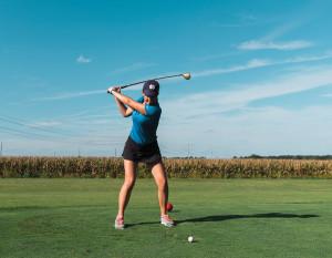 A Canterbury High School golfer takes a swing at Chestnut Hills Golf Club. photography by Dustin McKibben