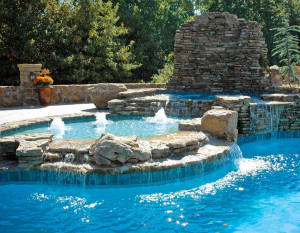 Customization is the biggest trend in pools. If you've got the money, you can create a tanning ledge and decorate your pool any way you want. photo courtesy of Latham Pools