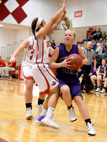 Webster City junior guard Halle Mason (10) attempts to drive past Boone's Caitlynne Shadle on her way to the bucket during the third quarter of Saturday afternoon's non-conference game in Boone. Mason scored two points in the Lynx 57-34 loss to the seventh-ranked Toreadors. DFJ photo/Troy Banning